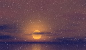 snowy scene of a gold glowing orb at the horizon over the ocean
